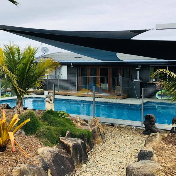 2 large shade sails over a pool
